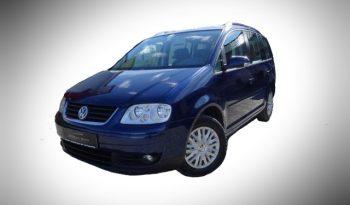 Volkswagen Touran for Rent Tirane - Speed Rental Car, Agjensi makinash me qera, lider ne Tirane per standardet e larta te shërbimit me çmimet më të ulëta.